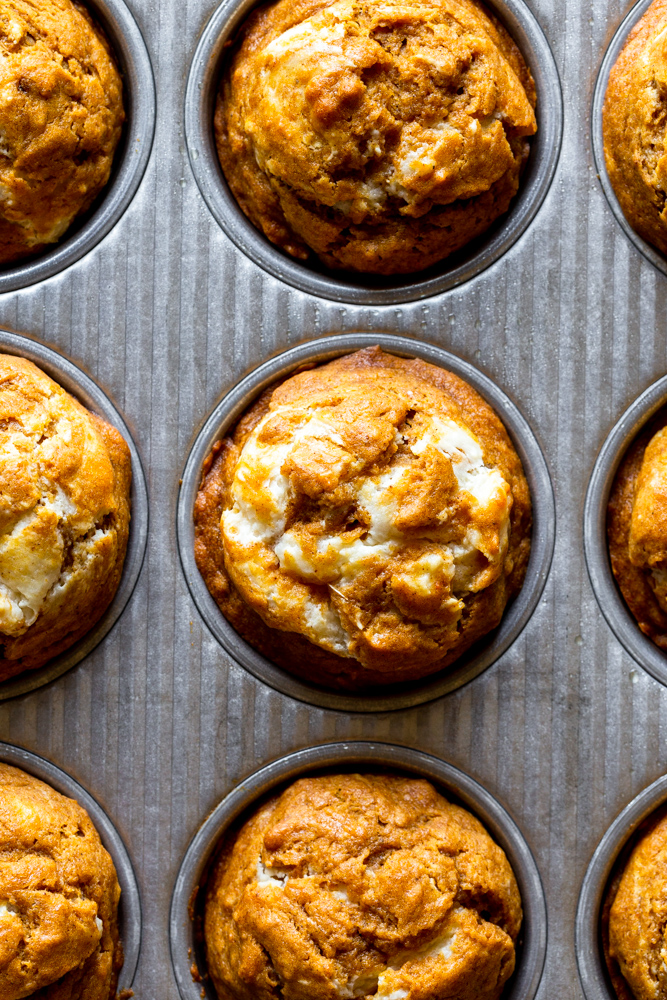 Baked pumpkin cream cheese muffins in muffin tin