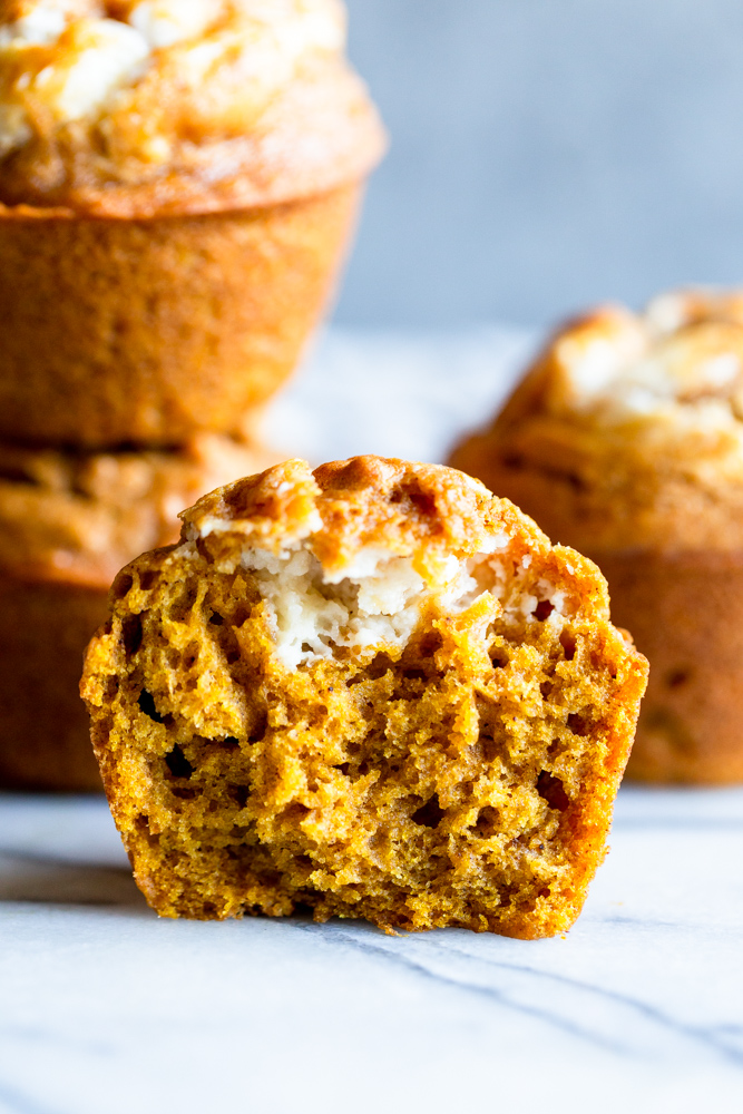 Cross section of pumpkin cream cheese muffin cut in half