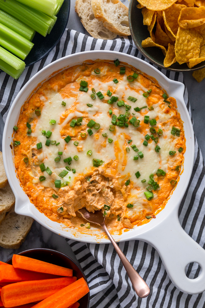 Buffalo Chicken Dip with carrots, celery, tortilla chips