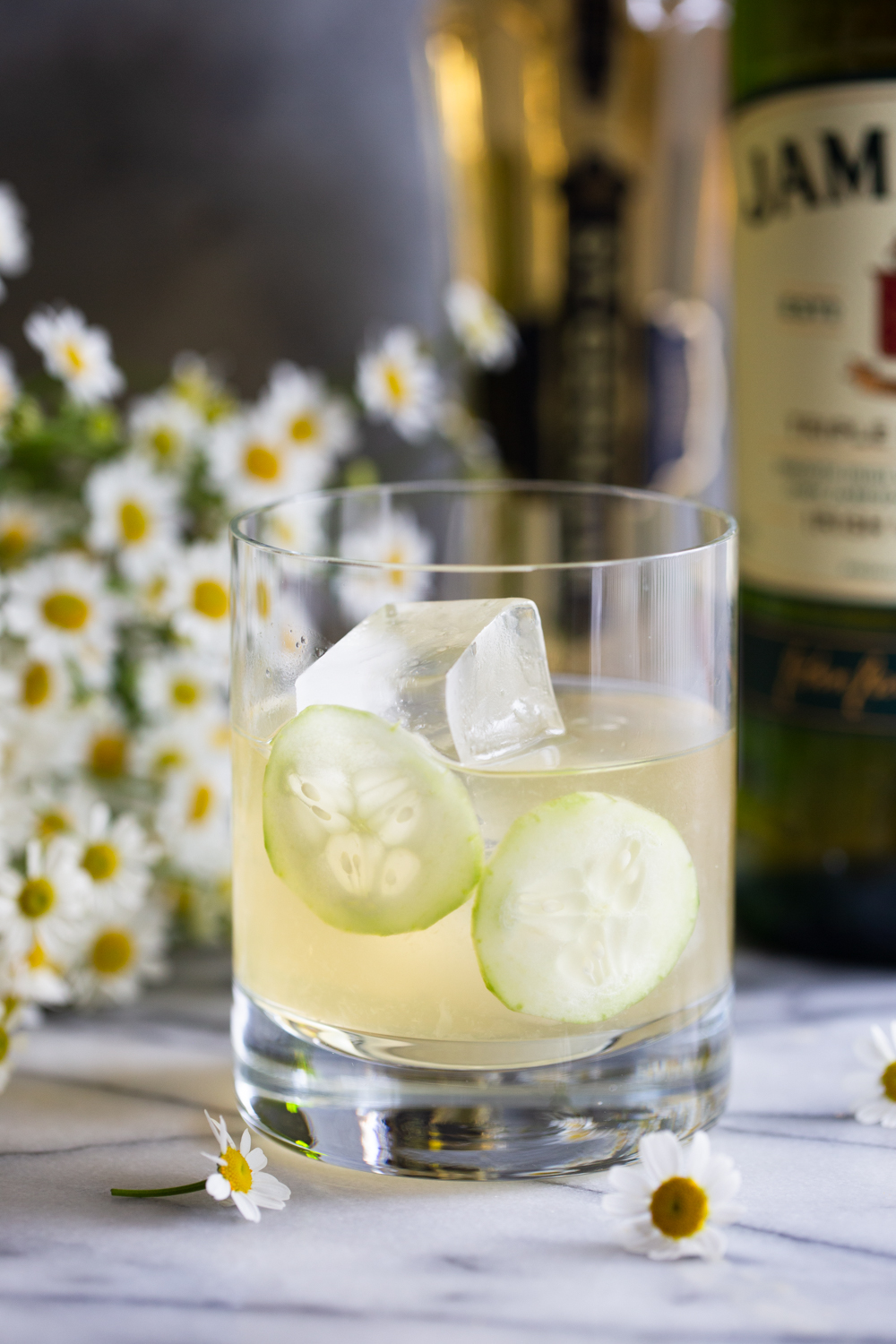 Irish maid cocktail with two cucumber slices for garnish