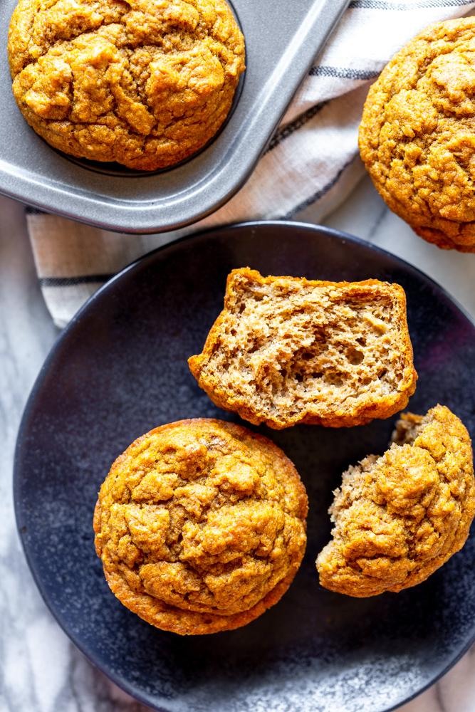 pumpkin banana muffin on a black plate