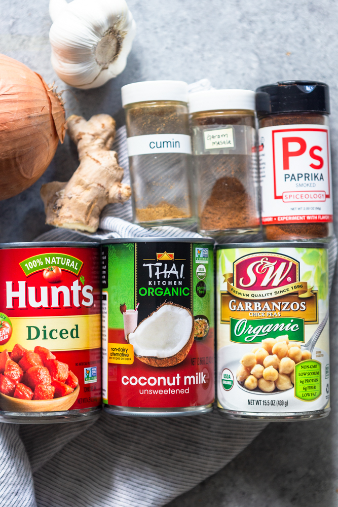 Ingredients for chickpea Curry: Onion, garlic, ginger root, cumin, garam masala, paprika, diced tomatoes, coconut milk, garbanzo beans
