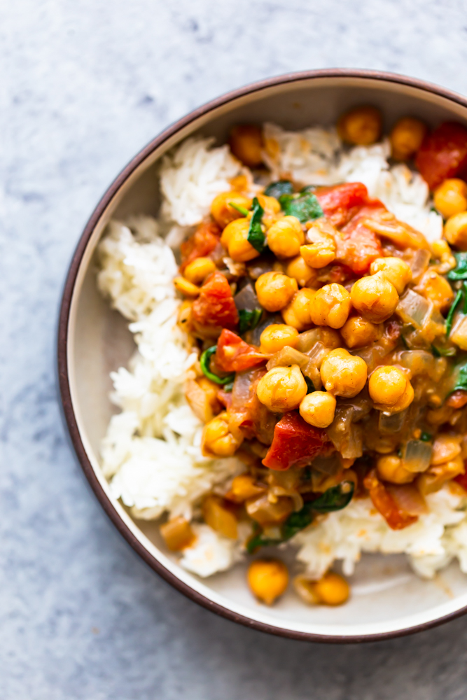 Chickpea coconut curry over rice in a bowl
