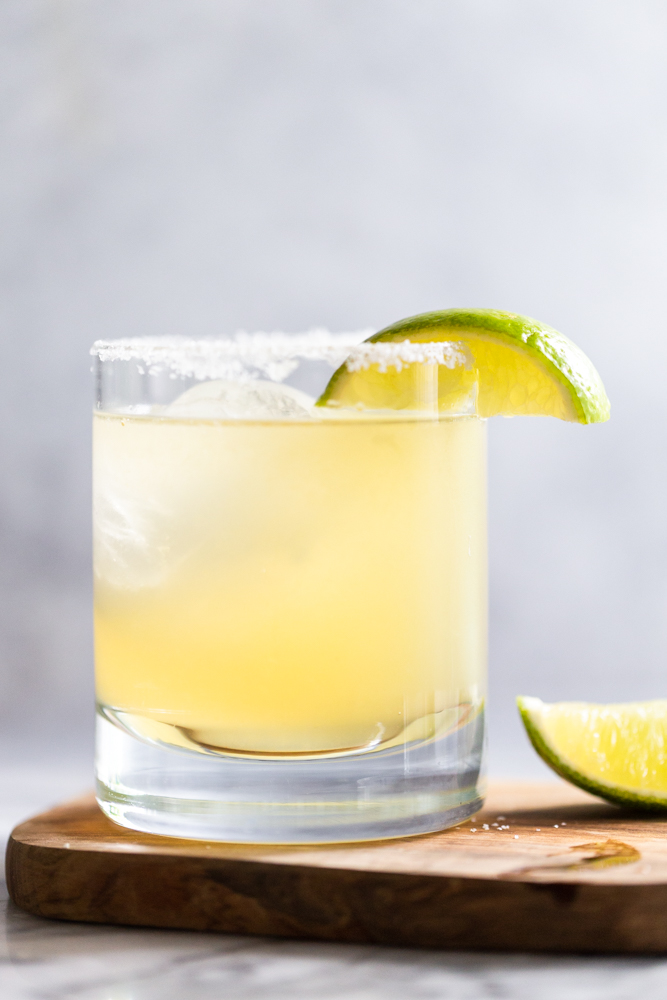 Margarita in a clear glass with lime wedge garnish.