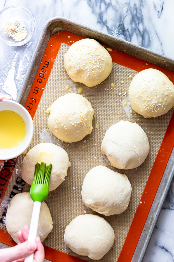 Brushing an egg wash on to unbaked burger buns