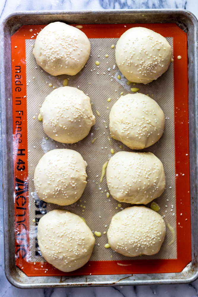 Unbaked hamburger buns ready to go into the oven