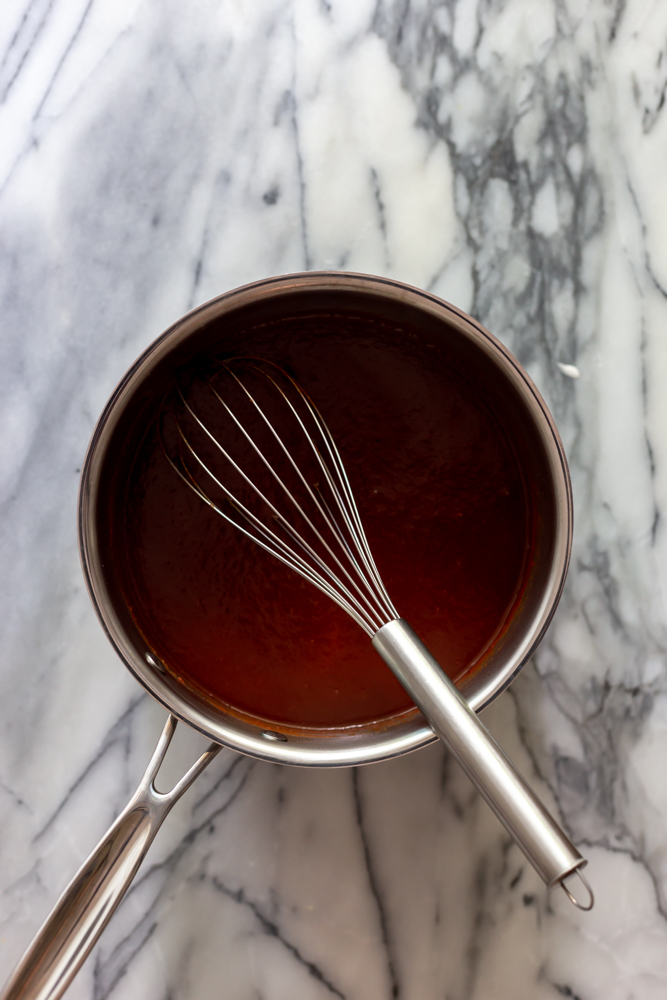 BBQ Sauce in a sauce pan with a whisk
