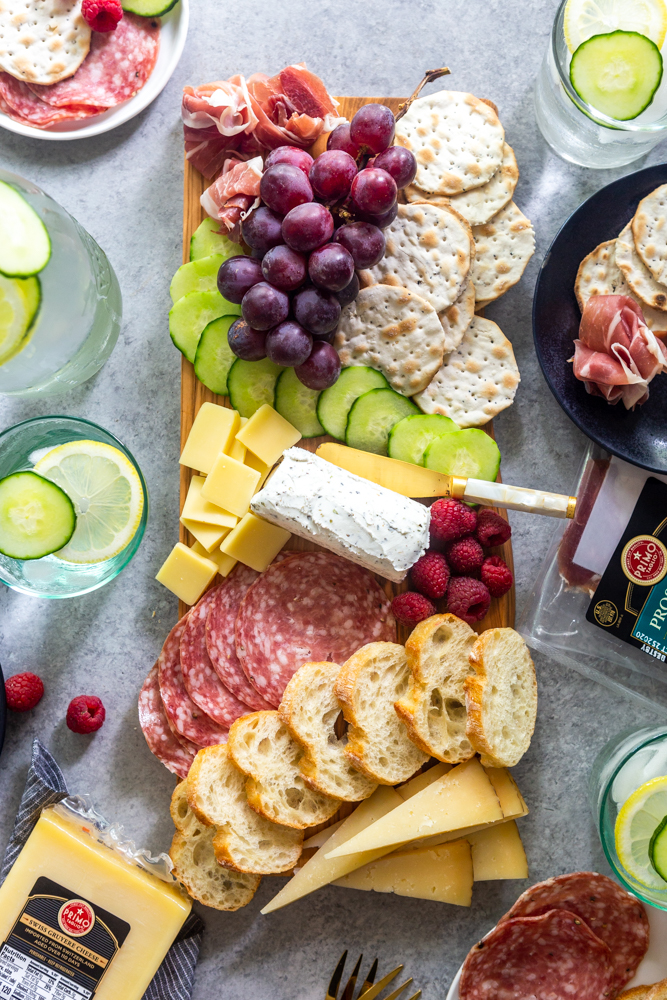 Meat and cheese board with grapes